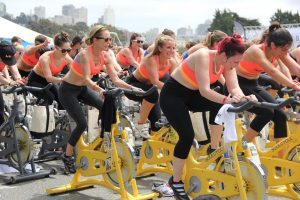 Group of women on stationary bikes